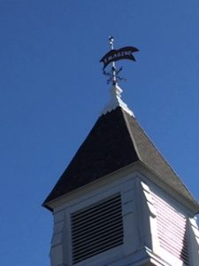 The Imagine Weathervane on top of the Library